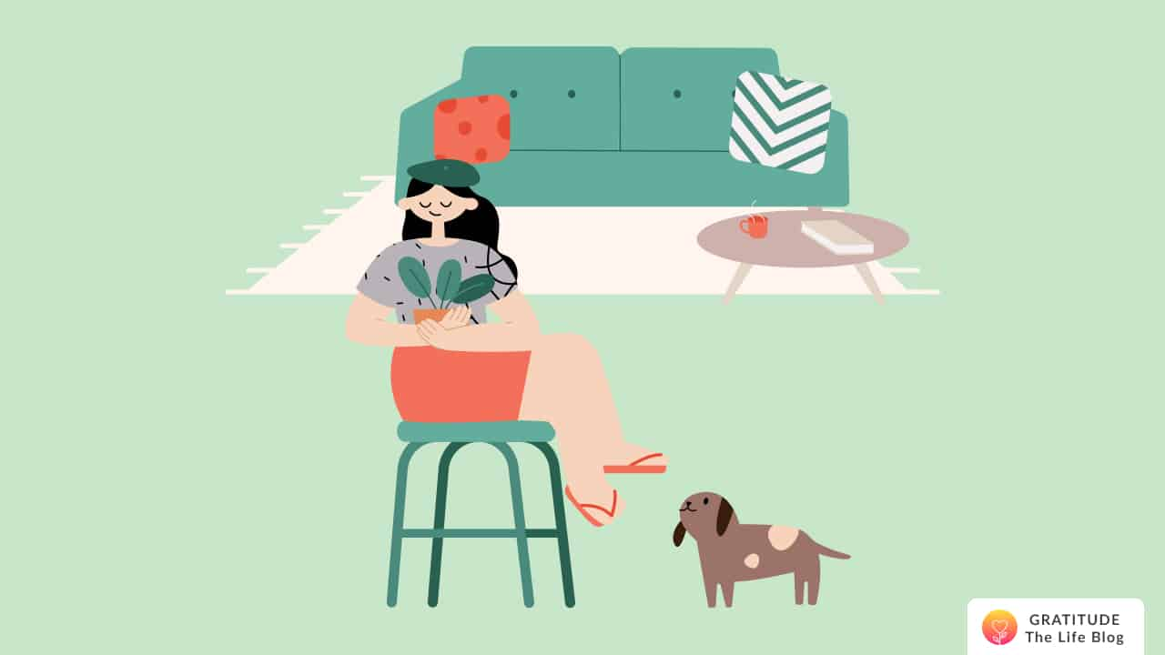 This is an image of a woman holding her plant, next to her dog, in her simple home
