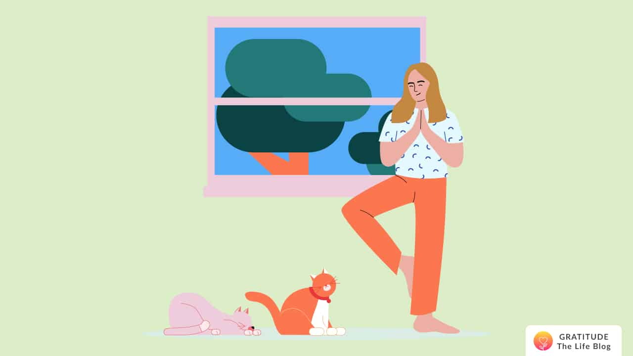 This is an image of a person standing and thinking positively next to their two cats