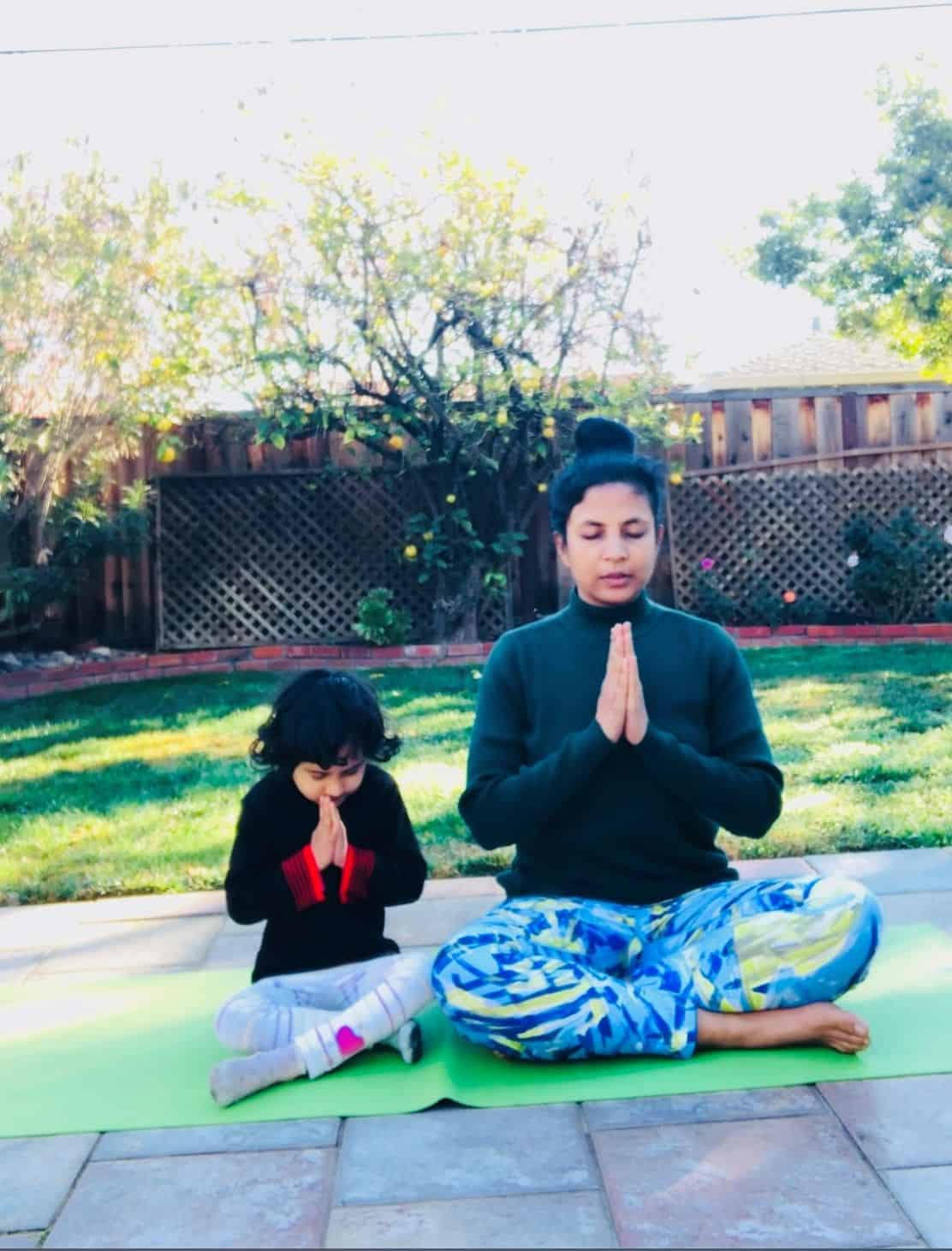 This is a photo of Keerti doing pranayama with her daughter, Milli
