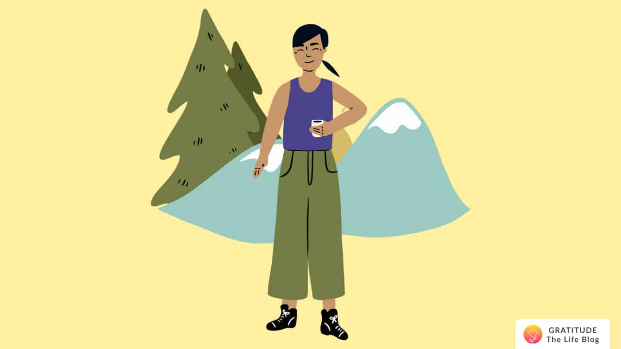 This is an image of a woman with mountains and trees behind her
