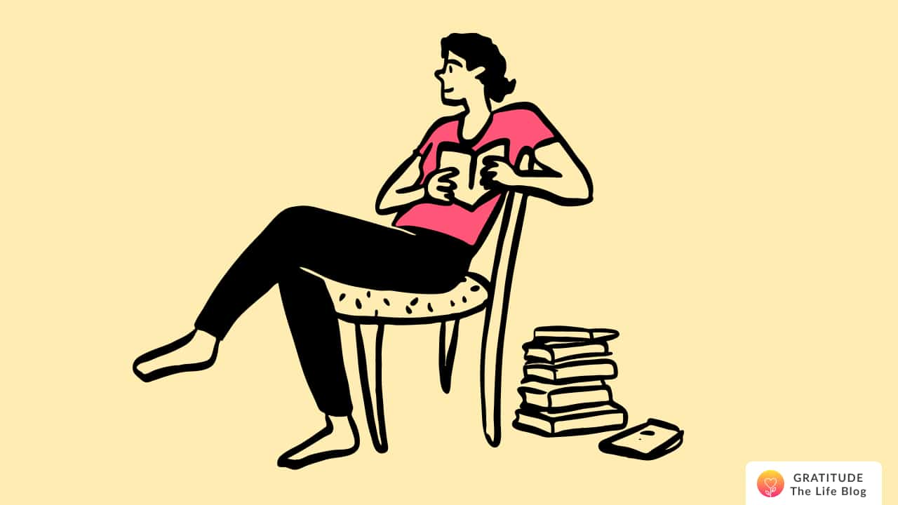 A man sitting on a chair, reading his journal to self-reflect