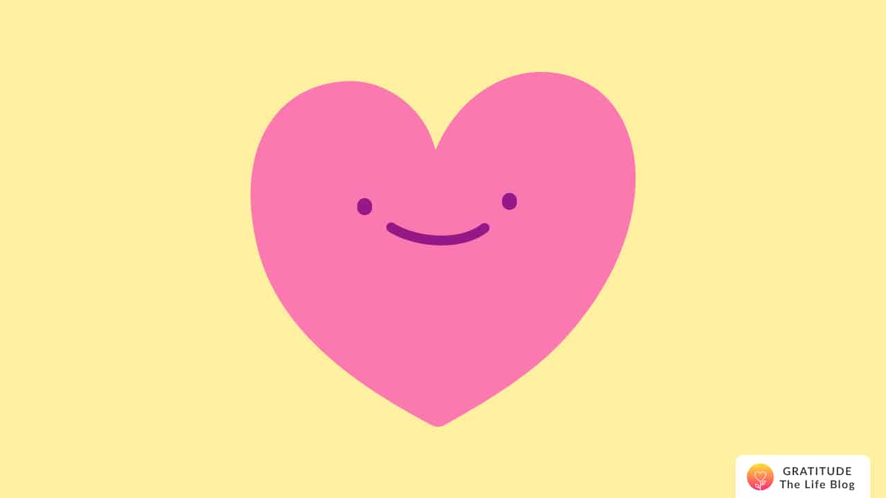 An illustration of a pink smiling heart