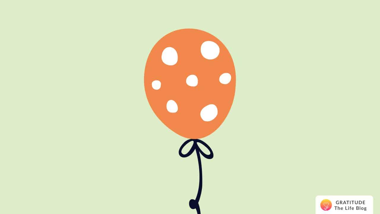 Illustration of an orange polka-dot balloon