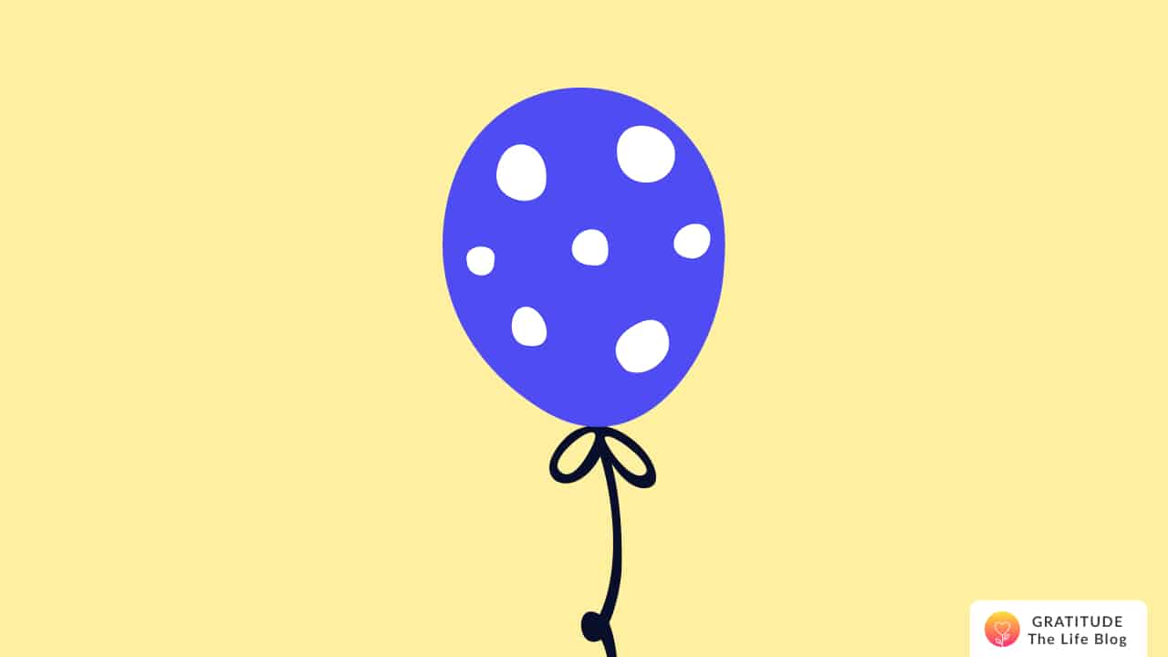Illustration of a dark blue polka-dot balloon