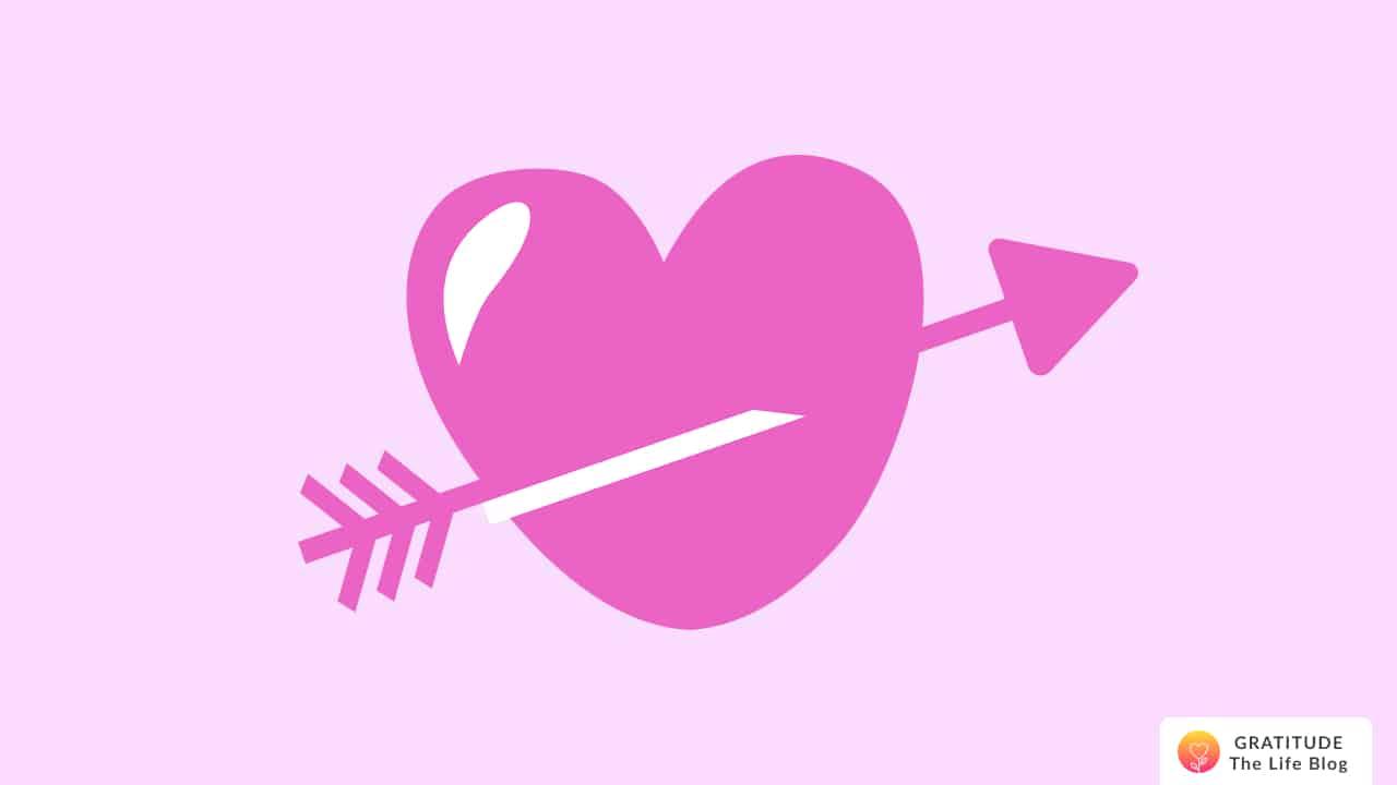 A soft pink heart with an arrow through it