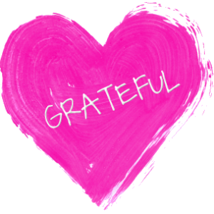 """A pink heart with the word """"GRATEFUL"""" written on it"""