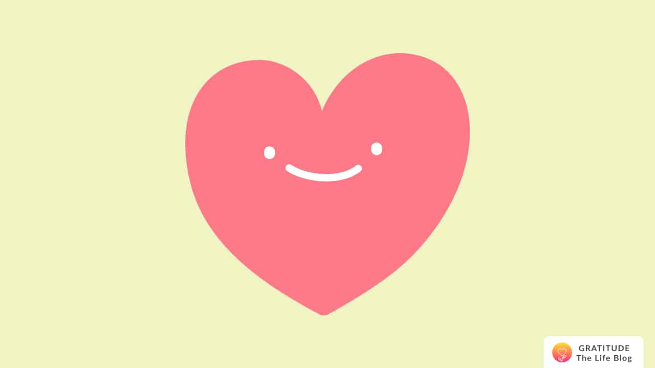 Illustration of a pink smiling heart